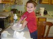 Riley mixing biscuit dough