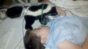 Caden and his favorite hospital buddy - Skunk